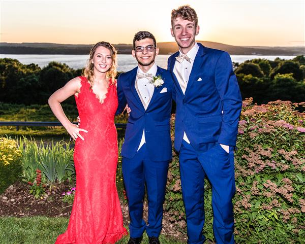 three students at prom